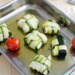 Zucchini-Bonbons mit Fisch und konfierten Tomaten